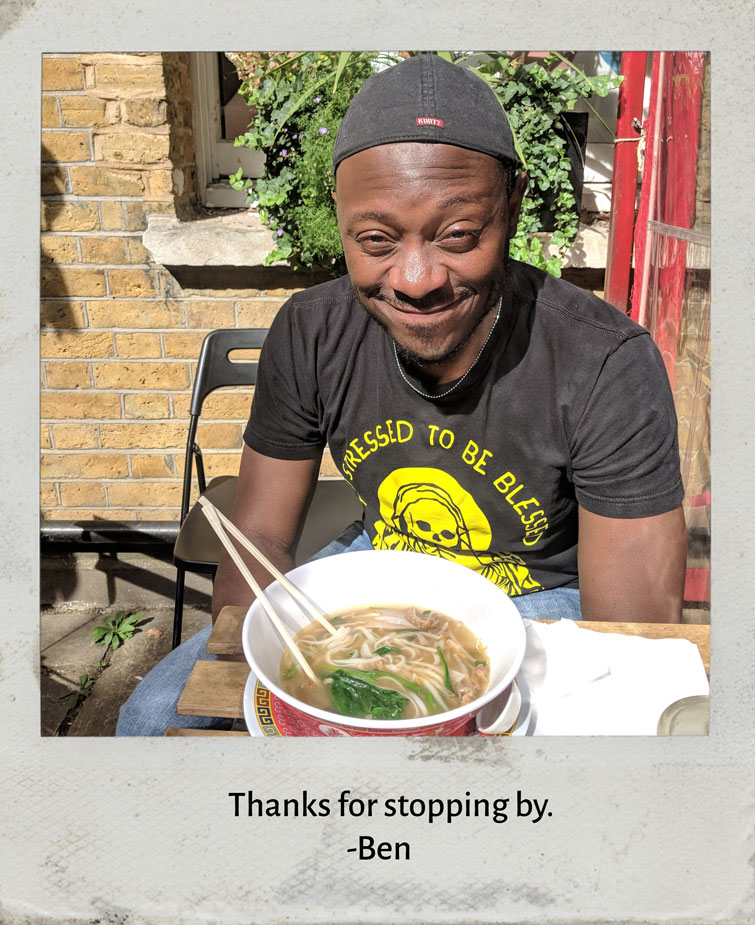 Photo of the author eating pho.